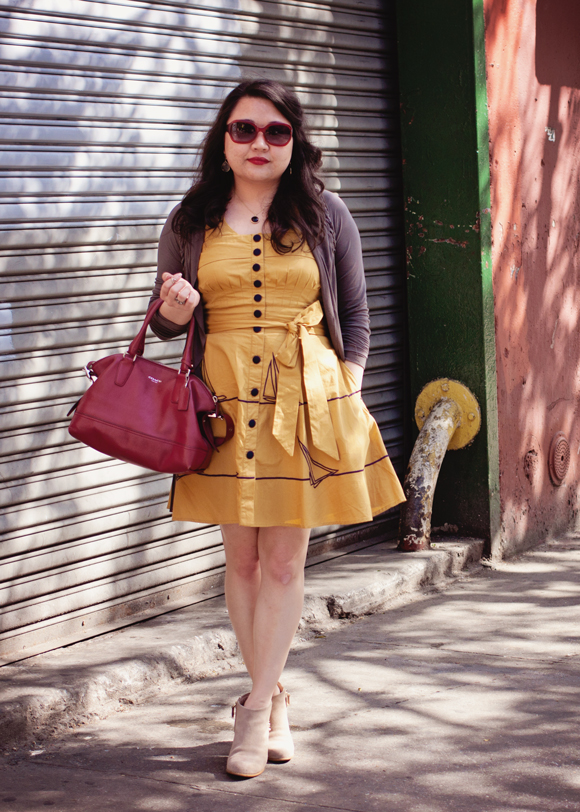 fashion blogger in a vintage inspired eshakti yellow sailboat dress and ankle boots