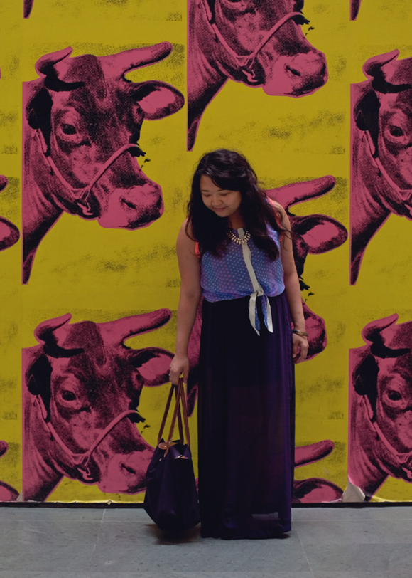 fashion blogger purple outfit posing at the moma andy warhol cow wallpaper
