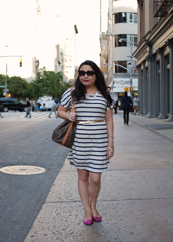 striped dress and louis vuitton petit noe bucket bag standing on the street in flatiron