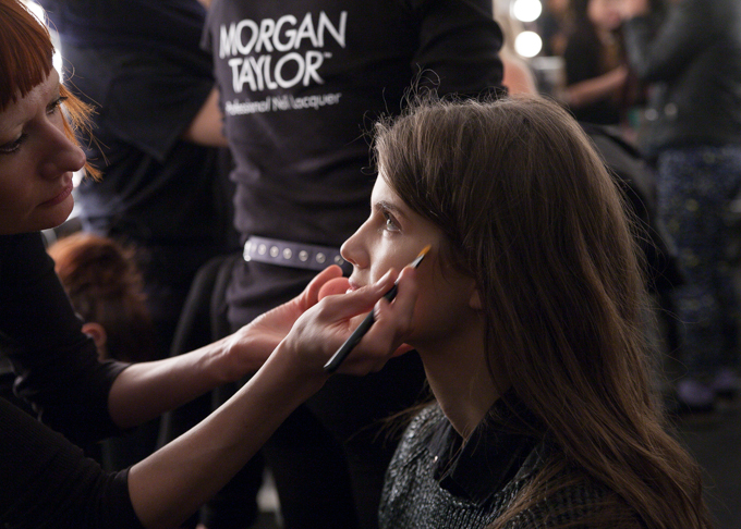 A model having her makeup done at Karolyn Pho Fall 2014.