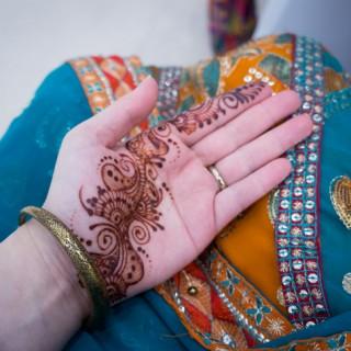Henna on palm and sari for a wedding
